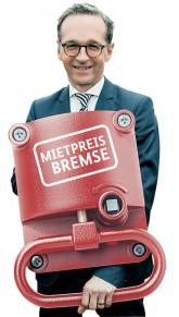 Bundesjustizminister Heiko Maas mit symbolischer Mietpreisbremse in Form einer Notbremse