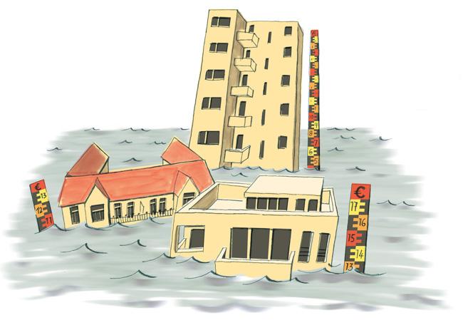 Gebäude versinken in Fluten, Messlatten zeigen den Stand der Überflutung