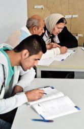 Migranten beim Deutschunterricht